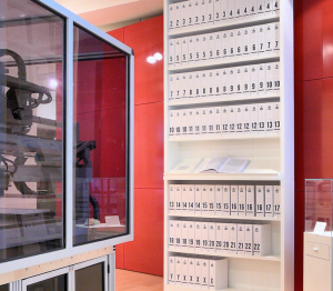 Human genome presented as a series of books at the Wellcome Collection, London. The 3.4 billion units of DNA code are printed into more than a hundred volumes, each a thousand pages long, in type so small as to be barely legible.   Image: Wikipedia